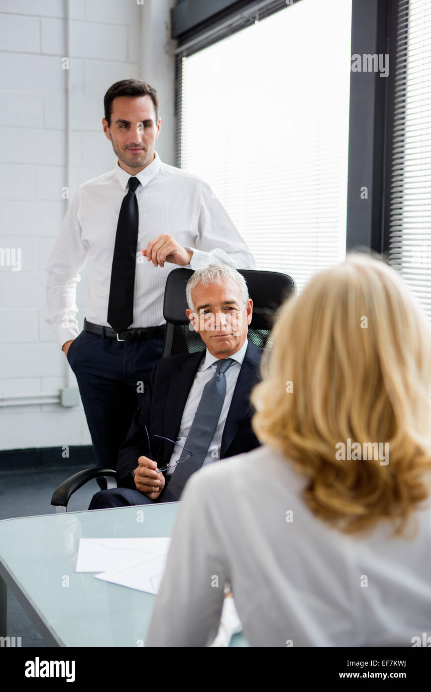 images of an executive instructing employees